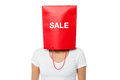 Young girl covering her face with shopping bag annual clearance sale started Stock Photo