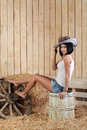 Young girl cowboy hat sitting barrel barn straw Stock Images