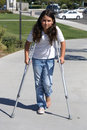 Young Girl with Crutches Royalty Free Stock Photo