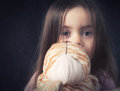 Young girl with cuddly toy a hold her looking straight in the camera cross processed Royalty Free Stock Image