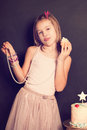 Young girl and cupcake Royalty Free Stock Photo