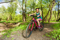 Young girl cycling mountain bike on forest trail Royalty Free Stock Photo