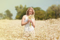 Young girl with daisies a beautiful blond in a field white Stock Image