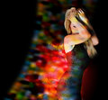 Young girl dancing bright nightclub lights smoke elegant dress black background Royalty Free Stock Images