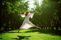 Young girl dancing in the garden Royalty Free Stock Images