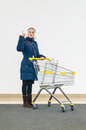 Young girl decide to go shopping with metal cart Royalty Free Stock Images
