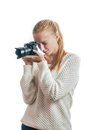 Young girl with digital camera taking a picture isolated on white Stock Images