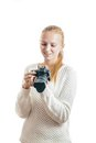 Young girl with digital camera taking a picture isolated on white Stock Photo