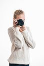 Young girl with digital camera taking a picture isolated on white Royalty Free Stock Photography