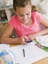 Young Girl Distracted From Her Homework Royalty Free Stock Photo