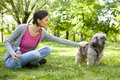 Young girl with a dog in the park Stock Photo