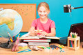 Young girl doing her homework smiling Royalty Free Stock Image