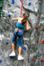 Young girl doing rock climbing Stock Photos