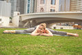 Young girl doing yoga against skyscrapers Royalty Free Stock Photo