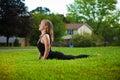 Young girl doing yoga exercise alone Stock Image