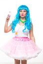 Young girl doll with blue hair. holding a mirror and handbag Royalty Free Stock Photo