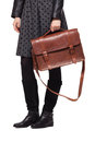 Young girl dressed in leather jacket with brown leather bag shoulder on white Royalty Free Stock Photography