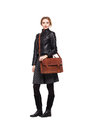 Young girl dressed in leather jacket with brown leather bag shoulder on white Royalty Free Stock Images