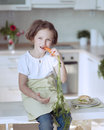 Young girl eating carrot Stock Images
