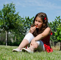 Young girl eating a fresh strawberry Royalty Free Stock Photo