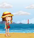 A young girl eating an icecream at the seashore