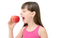 A young girl eating a red apple on a white background Royalty Free Stock Photo