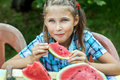 Young girl eating ripe watermelon Royalty Free Stock Photo