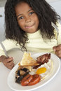 Young Girl Eating Unhealthy Breakfast Stock Photo