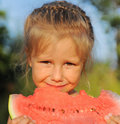 Young girl eating watermelon Stock Photography
