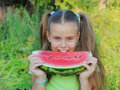 Young girl eating watermelon Royalty Free Stock Photo