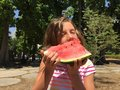 Young girl eating watermelon outdoors Royalty Free Stock Photo