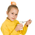 Young girl eating yogurt Stock Photos