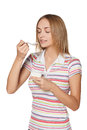 Young girl eating yogurt and smiling Royalty Free Stock Photo