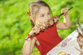 Young girl eats kebab little with pleasure shish Royalty Free Stock Photos