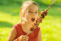 Young girl eats kebab little with pleasure shish Stock Photography
