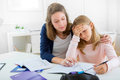 Young girl encounter difficulties during homework view of a Stock Images