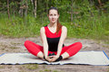The young girl engaged in yoga class a forest glade Stock Photo