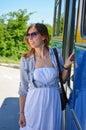 Young Girl Entering A Bus