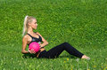 Young girl excersize outside with ball attracitive exercise pink on the grass in the park Stock Photography