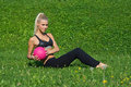 Young girl excersize outside with ball attracitive exercise pink on the grass in the park Royalty Free Stock Photos