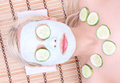 Young girl with facial mask of cucumber Royalty Free Stock Photography