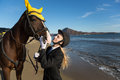 Young girl with a favorite horse on the beach autumn Royalty Free Stock Image