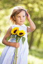 Young Girl In Field Holding Sunflower Royalty Free Stock Photo