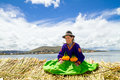 Young girl on a floating Uros island, Titicaca Royalty Free Stock Photo