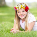 Young girl with floral wreath lying on a meadow Royalty Free Stock Image