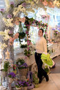 Young girl in a flower shop Royalty Free Stock Photo