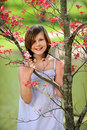 Young Girl By Flowering Tree Stock Photo