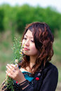 Young girl and flowers Stock Photos