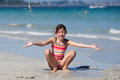 Young girl full of joy at the beach Stock Photography