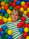 Young girl in fun balls Royalty Free Stock Image